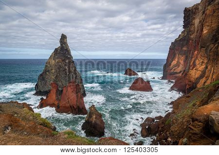 Volcanic rocks and dangerous shores of Atlantoc ocean. Madeira island rocky coast, Portugal.
