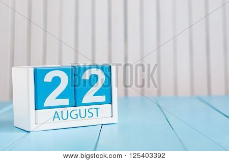 August 22th. Image of august 22 wooden color calendar on white background. Summer day. Empty space for text.