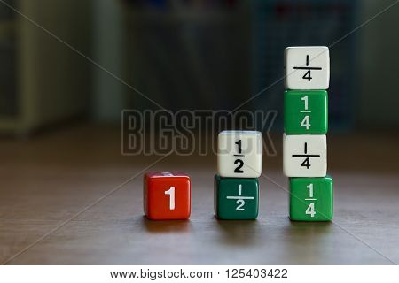 Fraction dices stack up on desk selective focus on dices blurred background