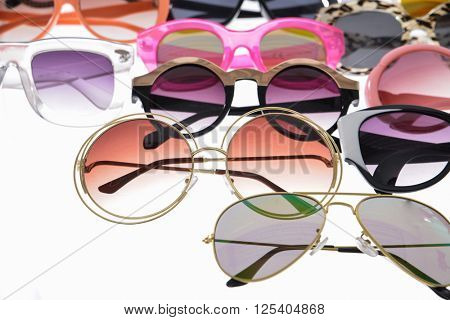 Assorted styles of tinted sunglasses isolated on white background