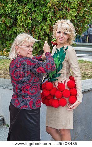 Dnepropetrovsk Ukraine - September 14 2013: Fashion designer prepares the model for exit at the podium