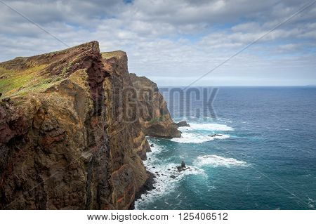 Rocky coast of Madeira. Volcanic mountains and high cliffs on the eastern tail of the island. Madeira, Portugal.