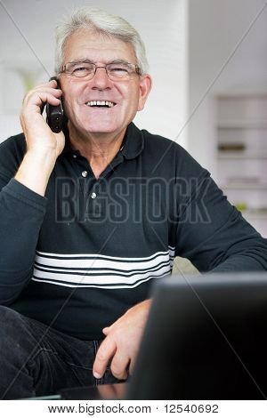 Portrait of a smiling senior man phoning
