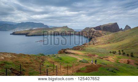 Tourists couple doing their hike at the beautiful landscape od Madeira island east coast. Casa do Sardinha, Madeira, Portugal.
