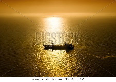 Night view of the ship in the Atlantic ocean in moonlight pathway