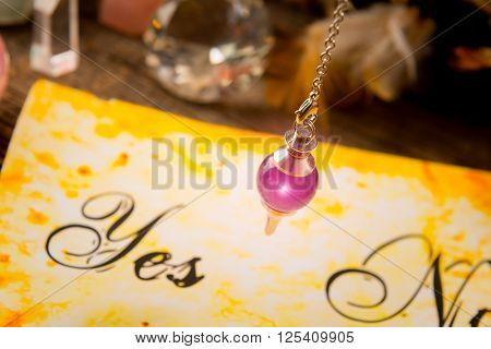 Pendulum, tool for dowsing over yes and no choosing diagram
