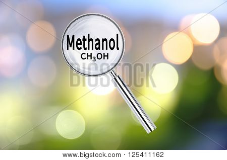 Magnifying lens over background with text Methanol, with the blurred lights visible in the background. 3D rendering
