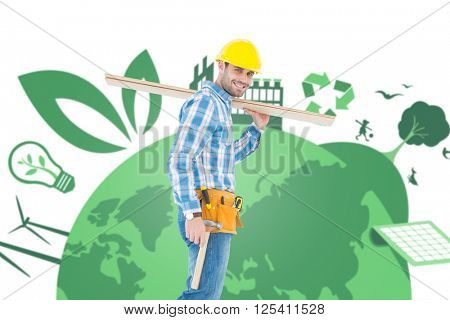 Smiling worker carrying wooden planks against fair trade graphic