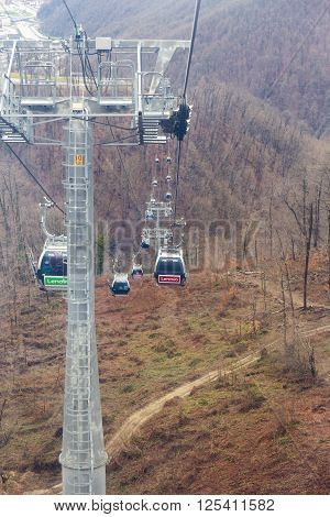 ROSA KHUTOR, RUSSIA - MARCH 27, 2016: Top view of Rosa Khutor cableway at the end of March
