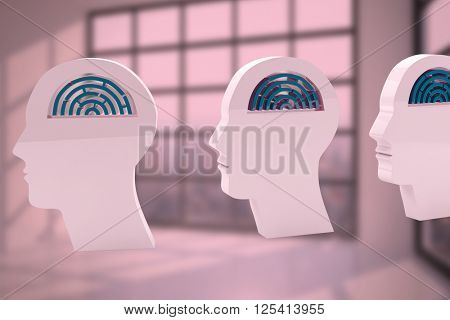 Maze brains in side profile heads against room with large window showing city
