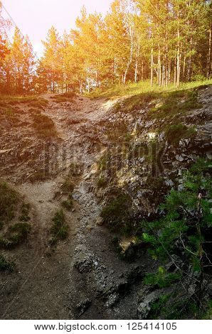 Summer forest landscape - marble high steep near the Sugomak cave in Southern Urals Russia
