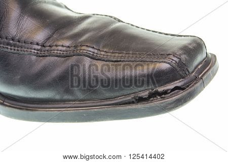 Broken black shoe isotaled on a white background