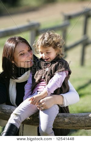 Portrait of a smiling woman with a little girl