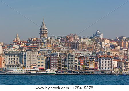 ISTANBUL, TURKEY - APRIL 27, 2015: Cityscape of Istanbul and view on Galata Tower from Bosphorus