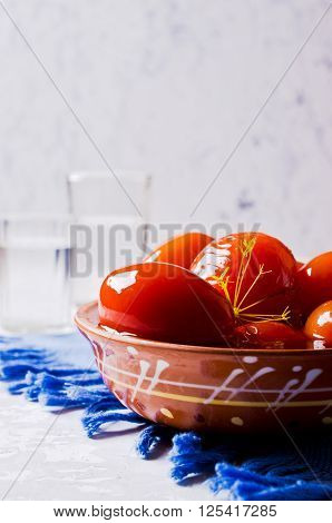 Homemade canned tomatoes in brine on the table. Selective focus.