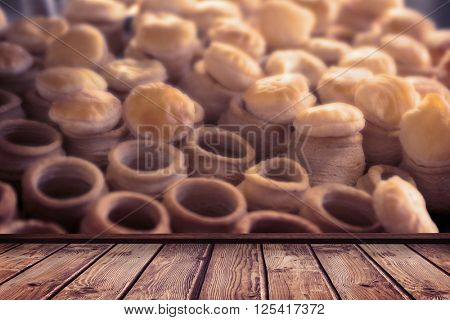 wooden planks against pastry case filling of delicious pastry