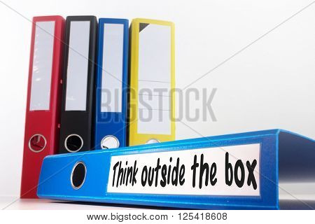 think outside the box against business desk with documents