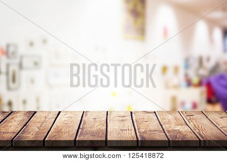 Wooden table against furniture and design store