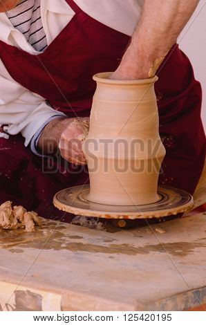 Potter Modelling A Clay Vase