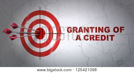 Currency concept: target and Granting of A credit on wall background