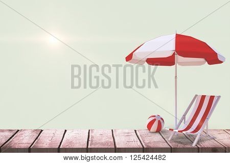 Image of sun lounger and sunshade against green background