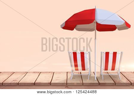 Image of sun lounger and sunshade against beige background