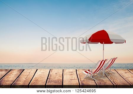 Image of sun lounger and sunshade against beautiful sunset on a sunny day