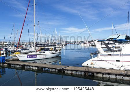 Yachts Moored Behind Wooden Walkway In Durban Harbor