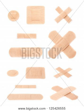 Set of multiple different adhesive bandage sticking plaster compositions isolated over the white background