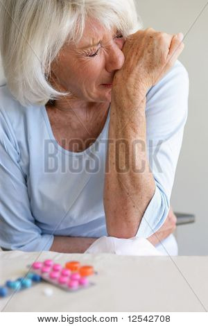 Portrait of a senior woman suffering from bellyaches