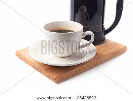 French press pot coffee maker and ceramic cup of coffee over the booden serving board, close-up composition isolated over the white background