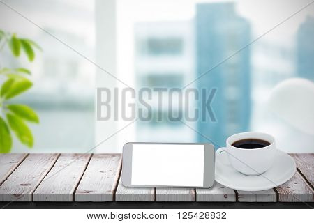 Picture of a smartphone against a cup of coffee