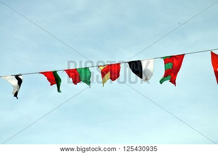 medieval flag pennants flapping in the sky