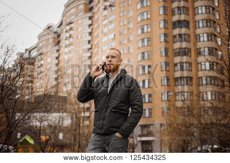 ginger man talking on the phone outdoors