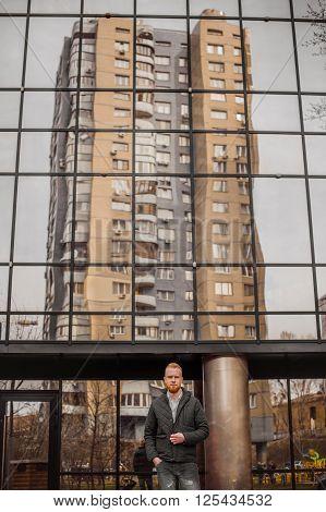 ginger man standing outdoor in urban city