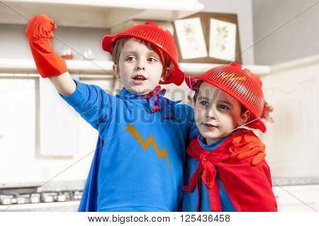 children playing at being wonderful hero in their home