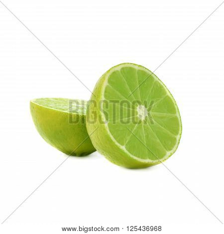 Two halves of a green lime fruit isolated over the white background