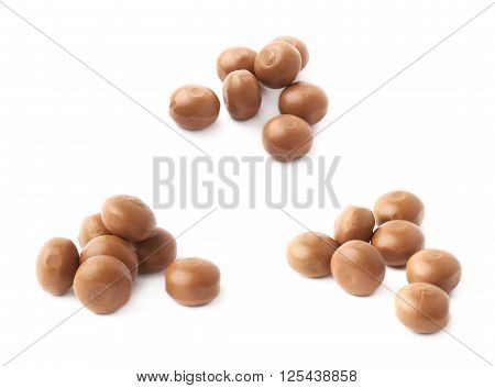 Pile of toffee caramel chewing candies isolated over the white background, set of three different foreshortenings