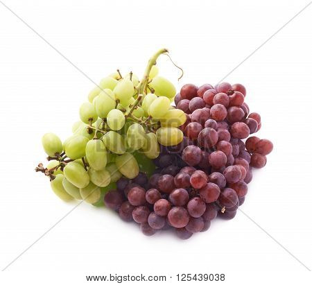 Branches of the dark and white grapes isolated over the white background