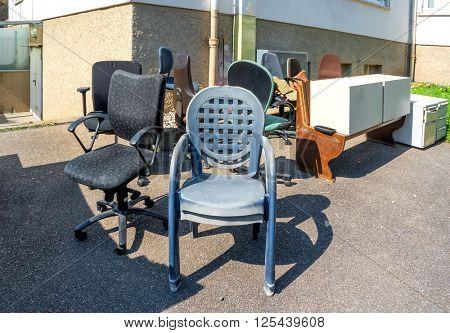 Big pile of broken office furniture