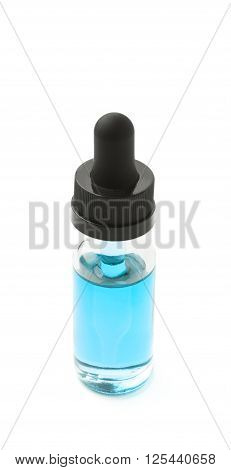 Small medical bottle with a pipette, filled with transparent blue liquid isolated over the white background