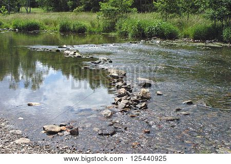 stream of a german running river stopped by stones