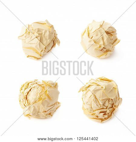 Crumple yellow paper ball isolated over the white background, set of four foreshortenings