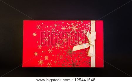 Gorgeous amazing closeup view of Christmas Holiday gift red box isolated on dark grey background