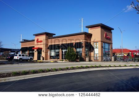 AURORA, ILLINOIS / UNITED STATES - APRIL 11 - 2016: People may eat fried chicken sandwiches and other items at the Chick-fil-A restaurant in Aurora.