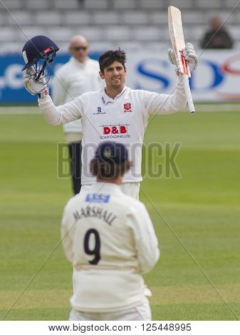 CHELMSFORD, ENGLAND - APRIL 11 2016: Alastair Cook of Essex raises his bat and celebrates scoring a century during the Specsavers County Championship match between Essex and Gloucestershire
