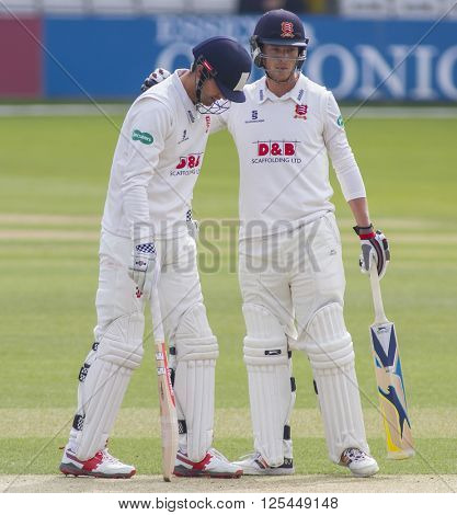 CHELMSFORD, ENGLAND - APRIL 11 2016: Alastair Cook (L) and Tom Westley (R) of Essex during the Specsavers County Championship match between Essex and Gloucestershire at the County Ground