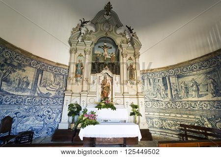 VILA DO CONDE, PORTUGAL - September 20, 2015: View of the chapel rococo style altarpiece with a statue of Our Lady holding the Child Jesus on September 20, 2015 in Vila do Conde, Portugal