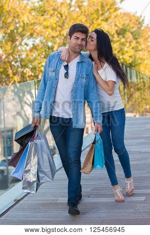 HAPPY SHOPPER WITH BOYFRIEND AND GIFTS
