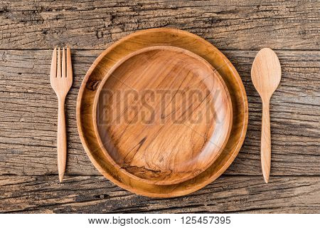 The Brown Wooden Plate On A Rustic Table Closeup. Horizontal Top View